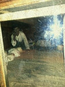 Photo of wax figures representing slaves who hid in the secret room.