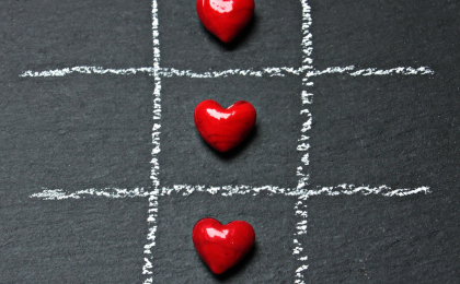 tic tac toe with red candy hearts. Is your heart hungry for love