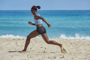 african-american woman running on the beach. God is calling