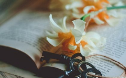 7 keys to overcome condemnation, keys and white and yellow flowers on a Bible